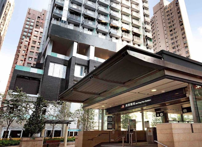 Mtr just right in front of the building, sai ying pui exit B3