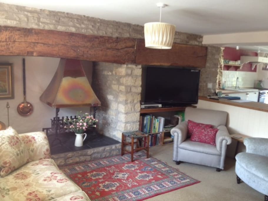 The sitting room has an inglenook fireplace