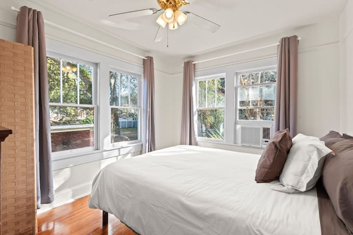 Light filled bedroom with queen bed