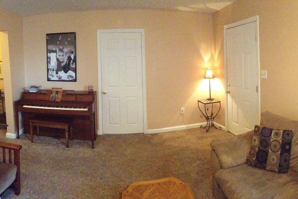 View from the opposite end of the living room. Play a tune for Miss Hepburn on the piano!