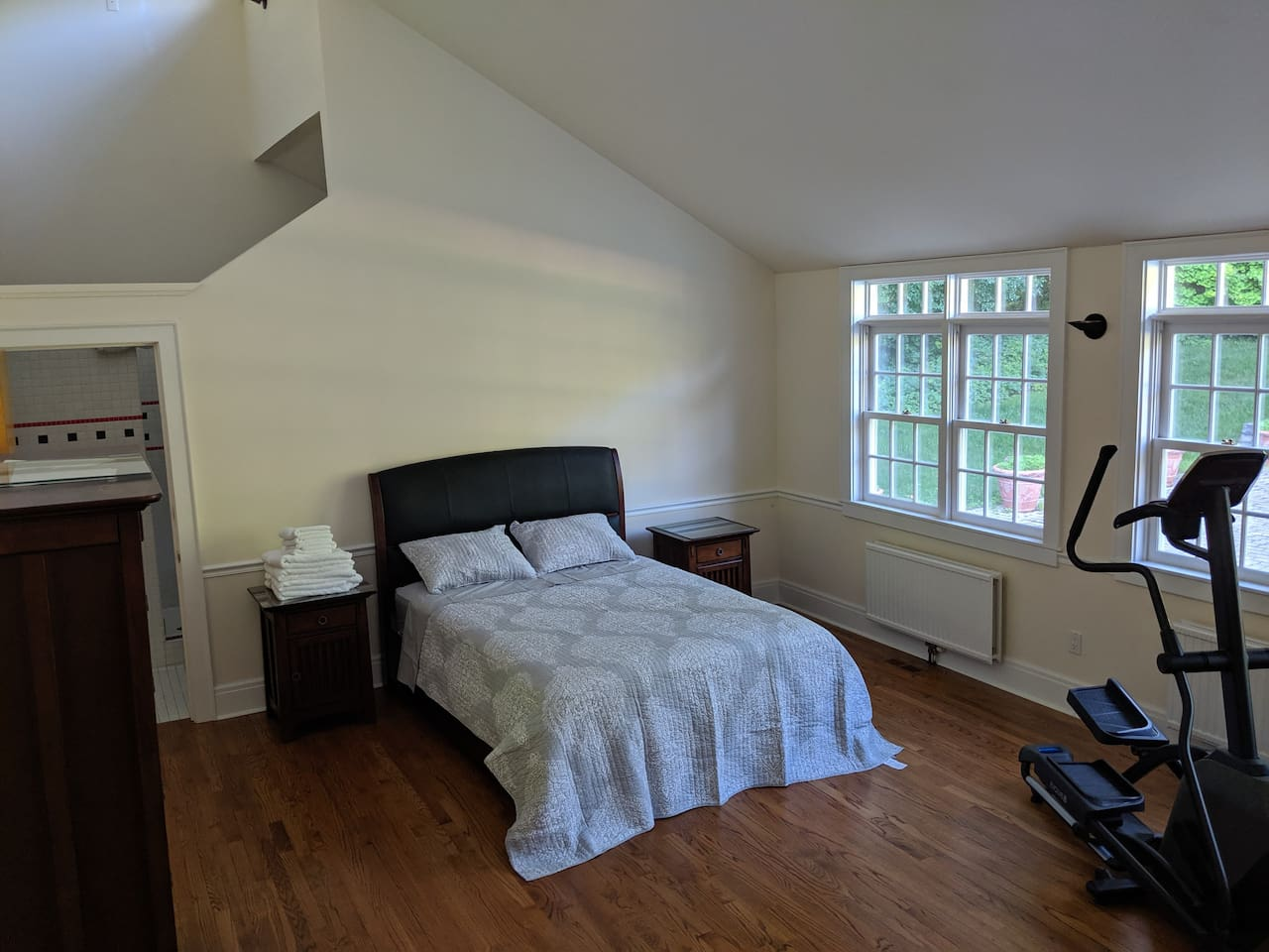 This is the guest suite bedroom. That is a queen bed. (The room is large, making the bed look small.) The doorway to the left leads to the hot tub room.)