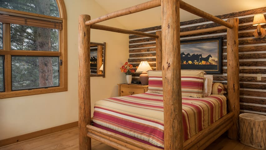 Wood canopy king bed.