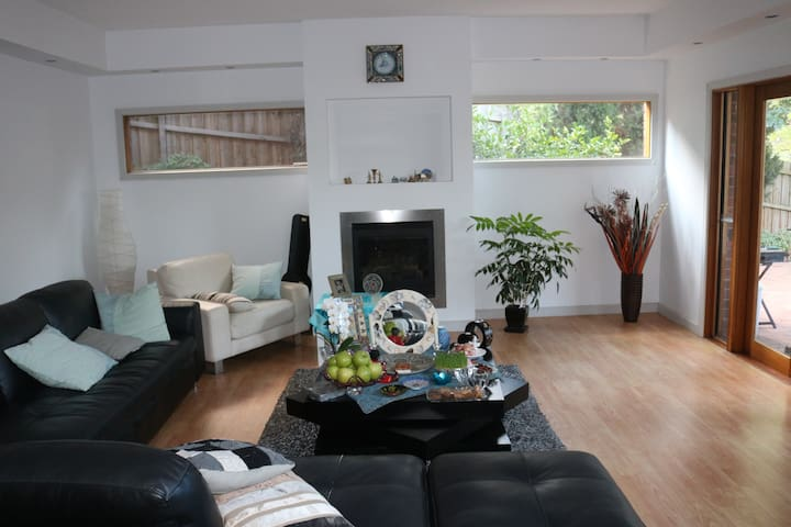 Spacious and bright private room with two big sofas and one queen size inflatable mattress