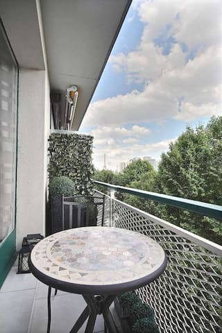 Here is the nice balcony with a beautiful view of the Eiffel Tower and Seine.