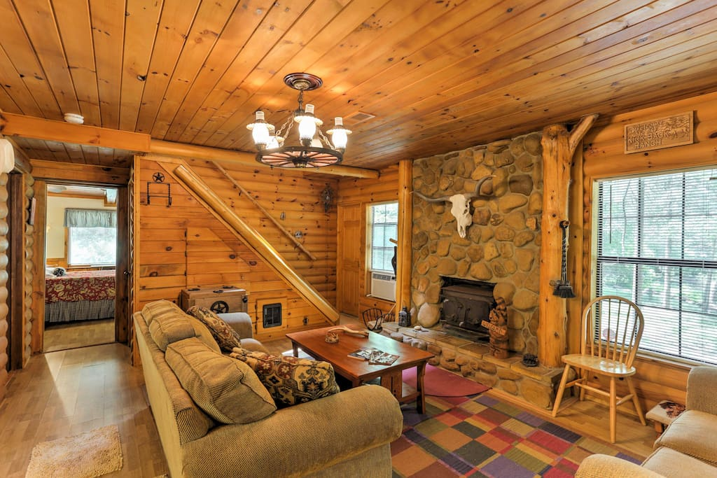 Step inside to make yourself at home in the rustic cabin with comfortable furnishings.