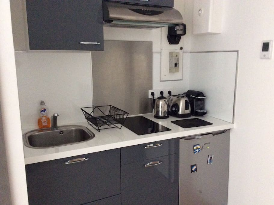 Kitchen with cooking table , toaster , water boiler and coffee machine