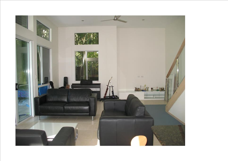 Very spacious, modern living area with 12' ceilings; lower level of split level 3 bedroom, fully self contained duplex.
