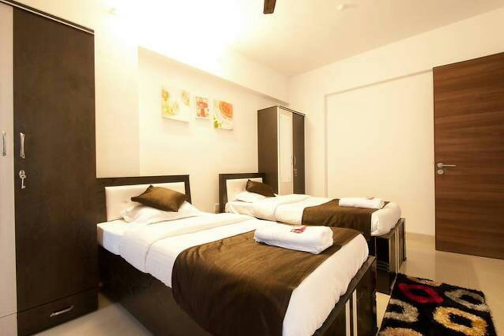 Twin bed arranged for double occupancy stay.