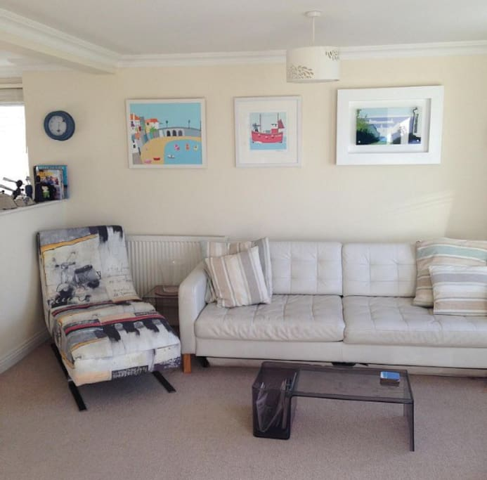 Art work by Caroline Dodd, Seb West and other local artists on the Living room walls.