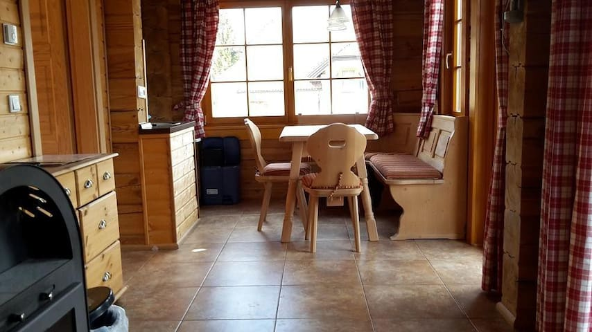 Charming wooden chalet located in a quiet hillside with beautiful mountain and valley views