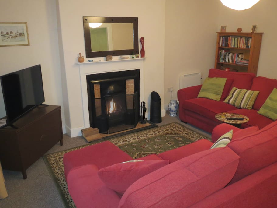 Barker and Stonehouse sofas, large smart TV and open fire