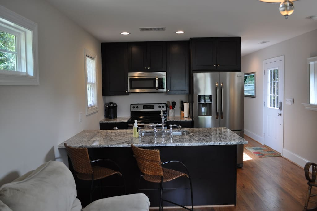Full kitchen, including stove, microwave, refrigerator, dishwasher, and coffee maker