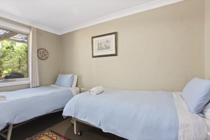 Second bedroom with two single beds + electric blankets for those cold winter nights
