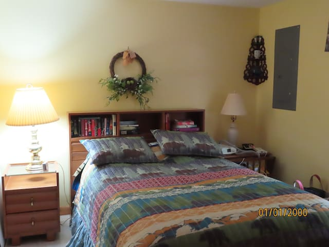 Comfortable double bed with memory foam overlay.