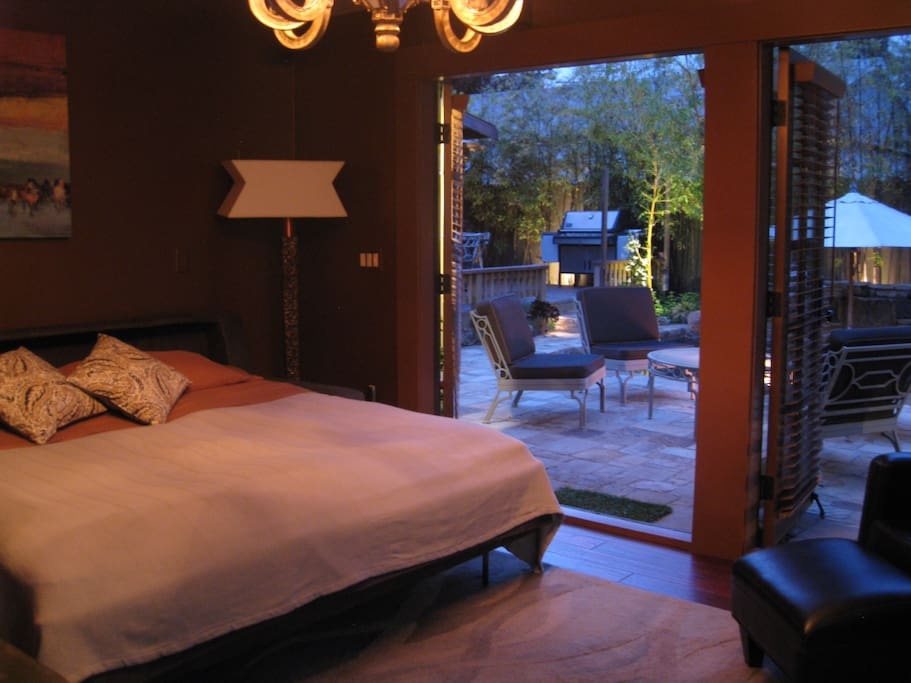 Your bedroom has 2 double French doors that open to the pool and fire pit.