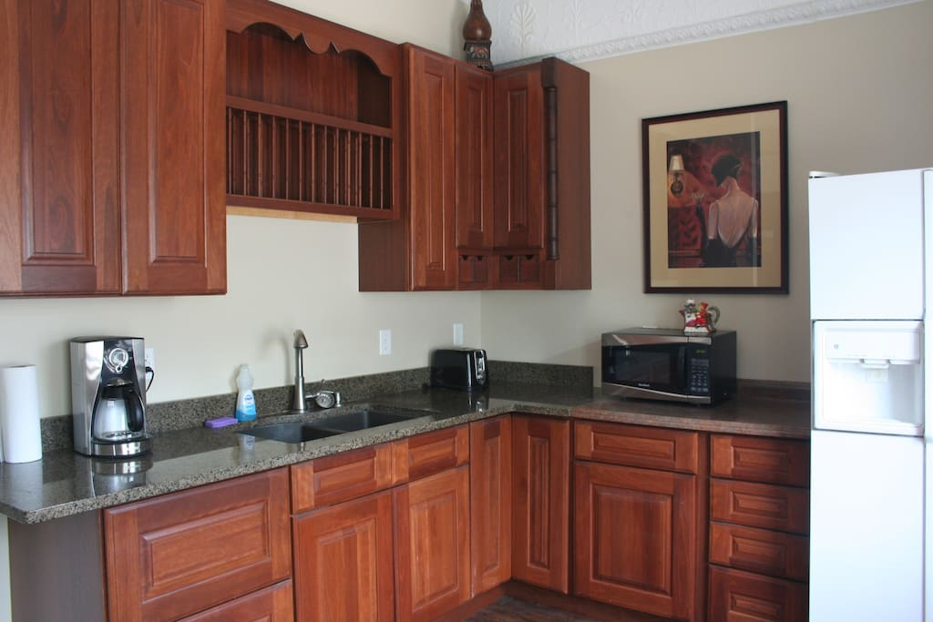 Room has kitchenette with fridge/freezer, microwave, coffee maker, toaster, dishes and utensils.