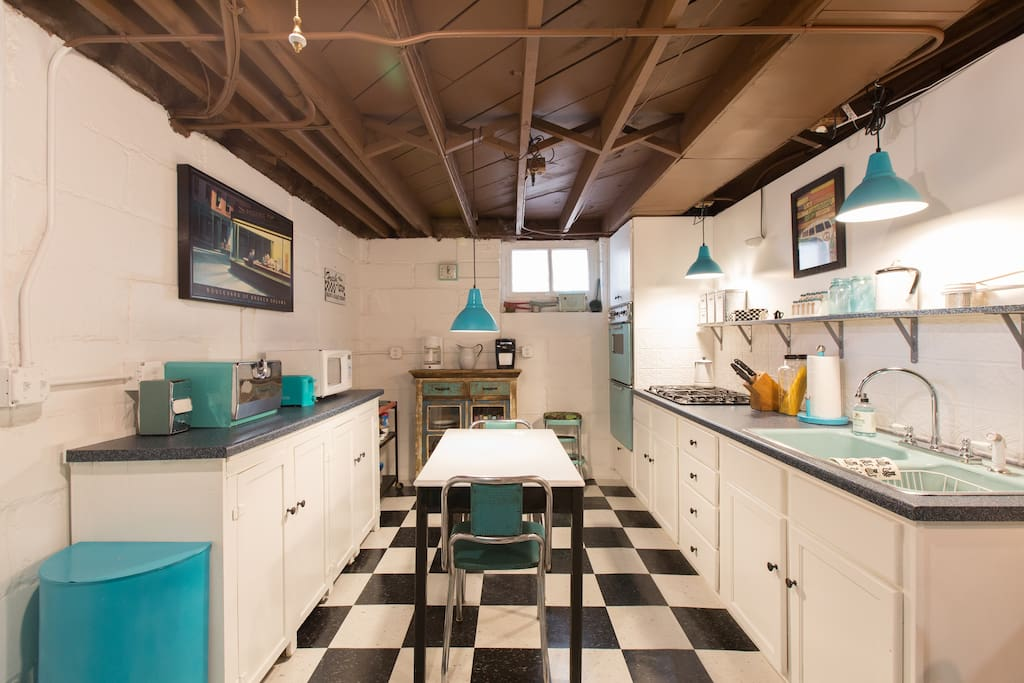 "The checkerboard floor adds a fun ""soda fountain"" feel to the kitchen."