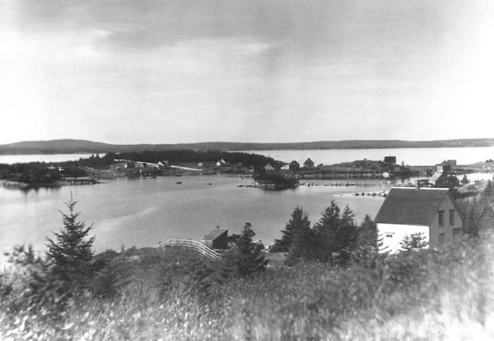 W.R. MacAskill photograph taken between 1920-1938 with our property in the foreground. NS Archives Photograph #200321632 https://novascotia.ca/archives/search/?q=indian+harbour%2C+ns.