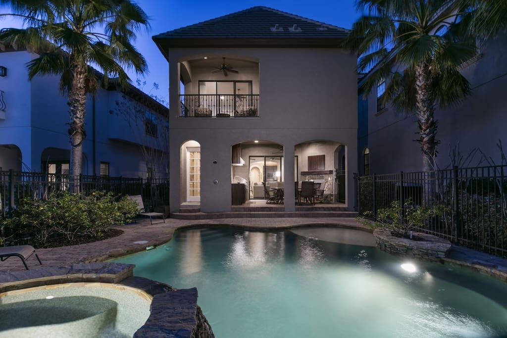 A beautiful lit pool creates an enchanting nighttime scene