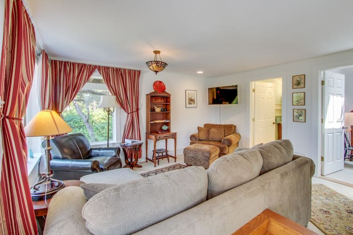 Dog-friendly getaway with outdoor fire & balcony - steps from beach access!