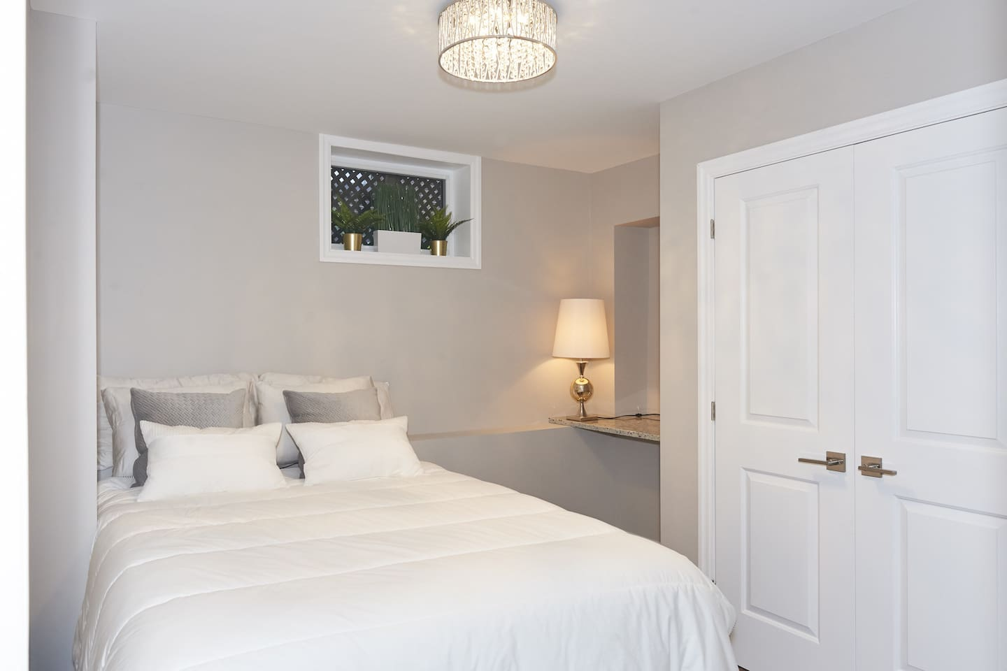 This spacious bedroom has a queen size bed with a comfortable and light duvet, a beautiful granite desk, as well as a full size closet and hangers.