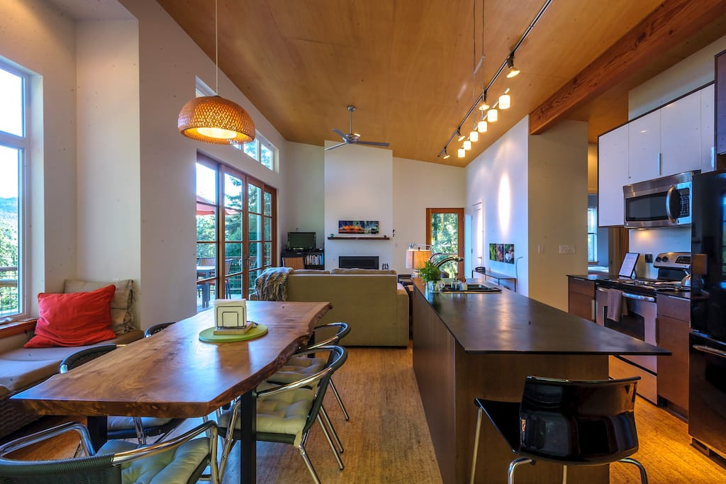 Airy open plan living with cork floors and vaulted wood ceiling.