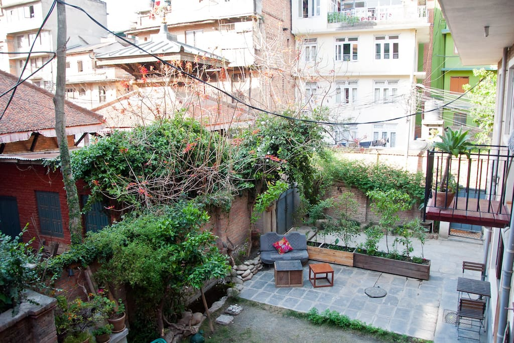 Cosy garden with sitting space, small fish pond and view over Narayan Temple...