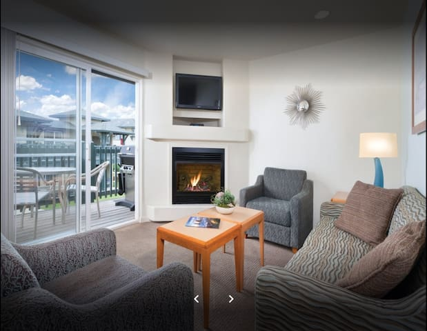 Living Room with TV, DVD Player, Fireplace and View of Balcony with BBQ Grill