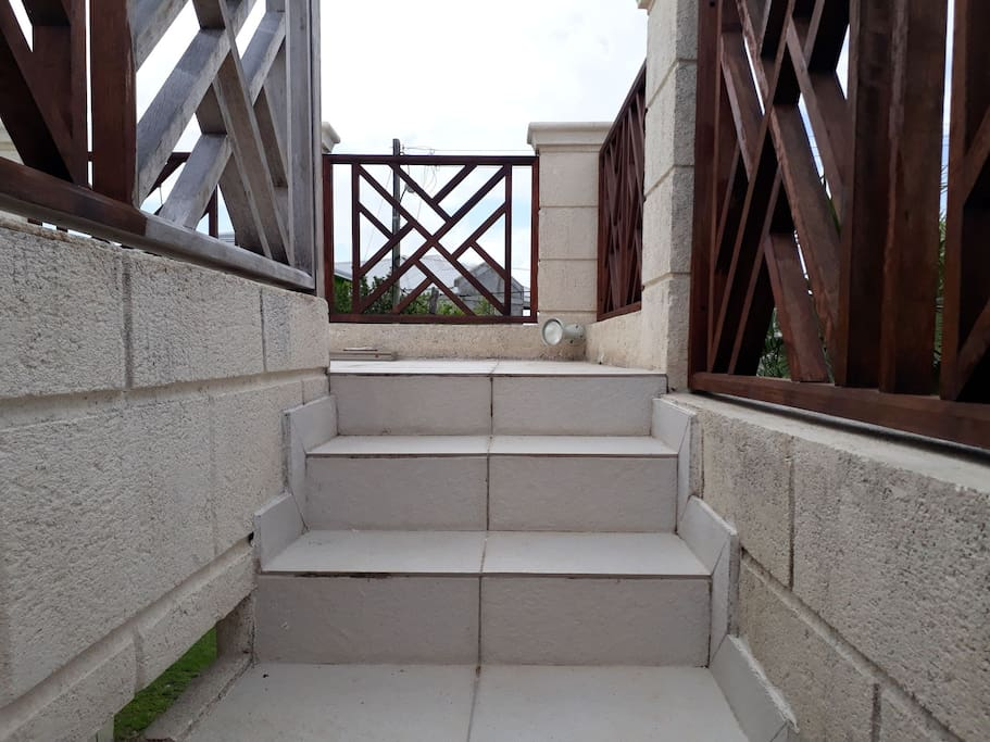 Stairs leading to upstairs deck