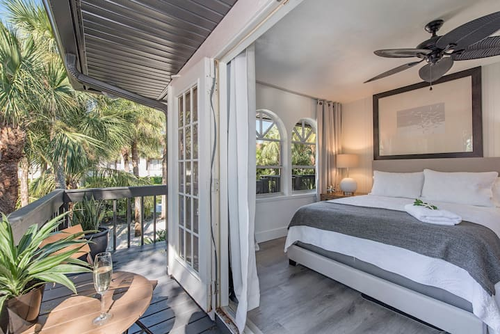 Private Entry and Outdoor Area On Wrap Around Deck off of the Lux queen studio tight fits queen bed table and chair en-suite to amazing Lux soaking tub Bathroom with small shower, mini fridge, microwave, coffee, and washer dryer.