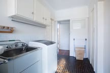 Laundry with washing machine, drier and ironing facilities. Separate toilet also.