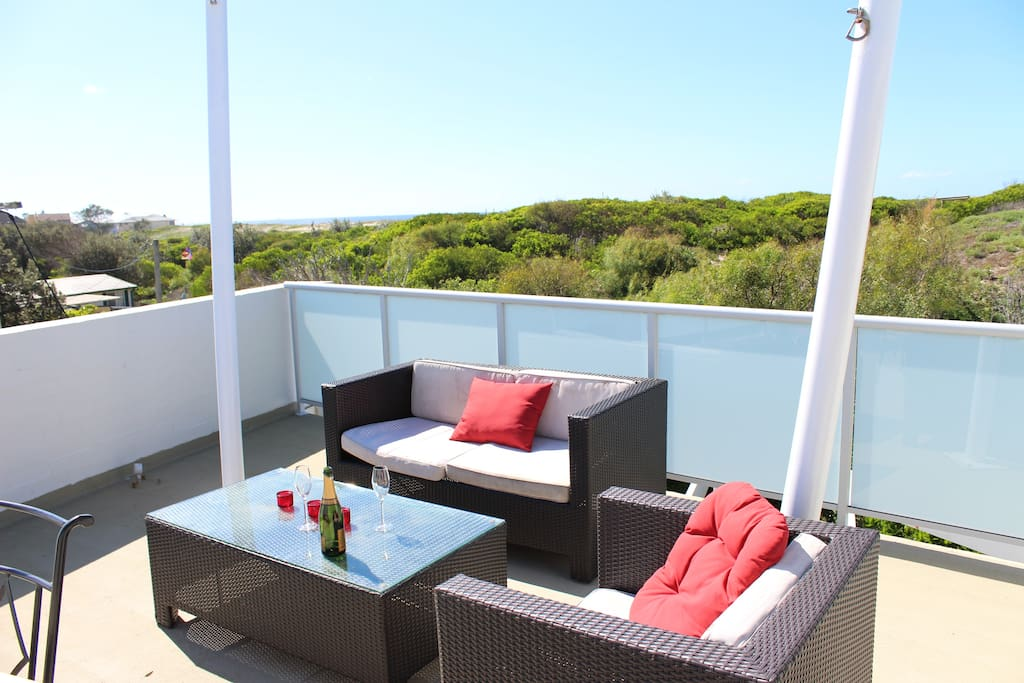 Rooftop balcony with ocean glimpses and BBQ