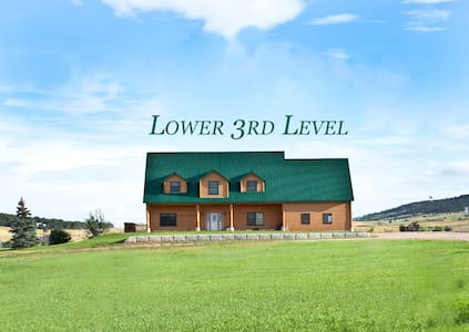 Three newly remodeled bedrooms in our downstairs apartment with high ceilings.  Large sitting area with fireplace.  Refrigerator, microwave & skillet provided.    No stove, but gas grill in summer.  1.5 miles north of Rapid City.  Your own entrance.