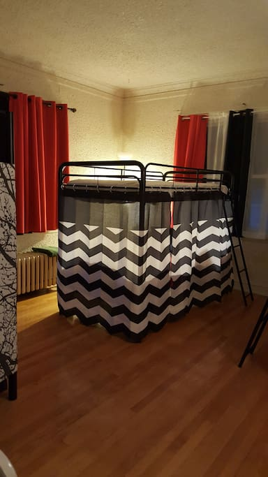 Bedroom #2 - Bunk beds with privacy screen on bottom beds