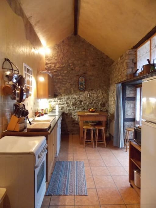 Fully equipped kitchen in old restored smokehouse.