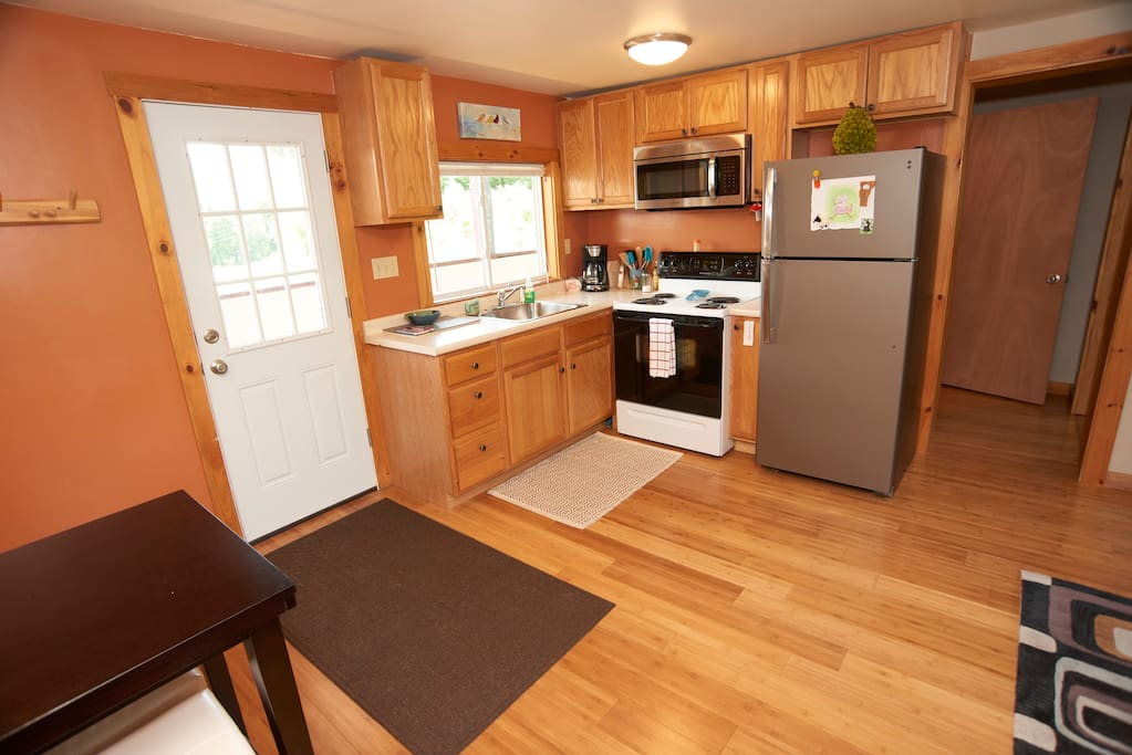 Full kitchen with electric stove