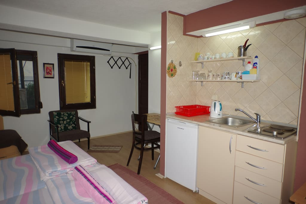 Kitchenette with mini fridge and desk