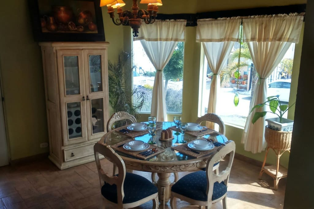 Lovely dining area with bay windows.