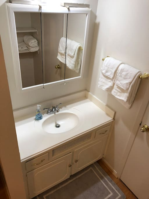 Private vanity area. Door leading to bathroom.