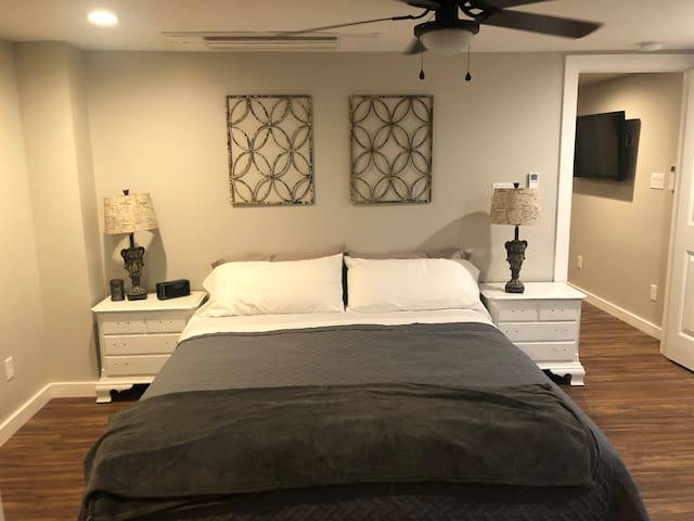 """Lower Level Master Bedroom.  Headboard and drawer pulls """"Coming soon""""."""