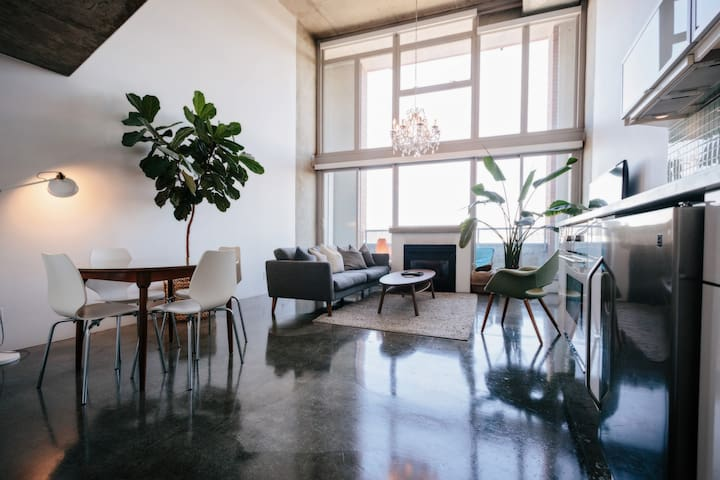 Two level loft with 16ft floor to ceiling windows and polished concrete floors.