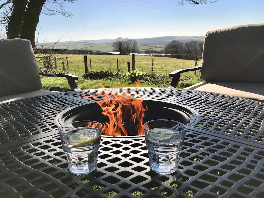 Enjoy long evenings around the fire pit and barbecue with views across Cornwall