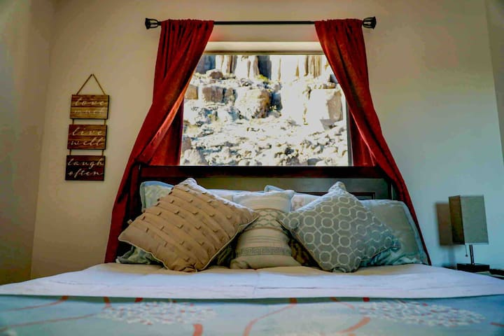 Bedroom with a Double bed (not a queen) and the backdrop that looks like a little Grand Canyon!