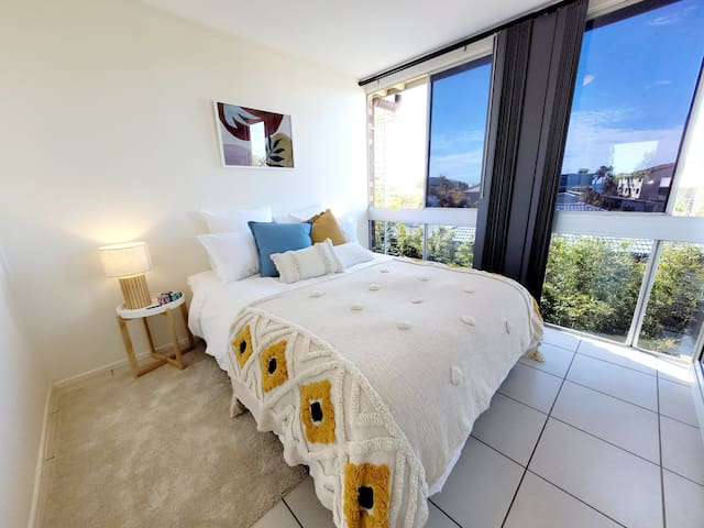 Master bedroom with ocean views over to Moreton Island.
