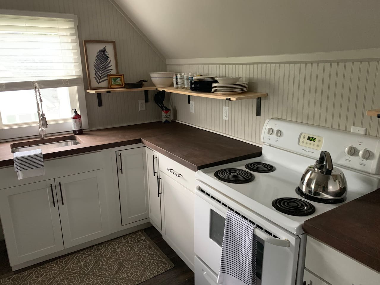 Kitchen with stove, fridge, dishwasher, microwave, washer and dryer. We have a coffee pot with coffee along with dishes and pots and pans to cook with. Eat in or take a short walk to an excellent coffee shop and pizza place!
