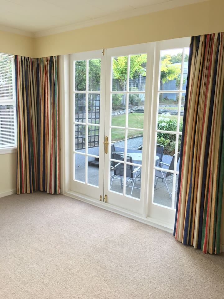 Own spacious Living Room open up to private outdoor seating and Garden area through French Door