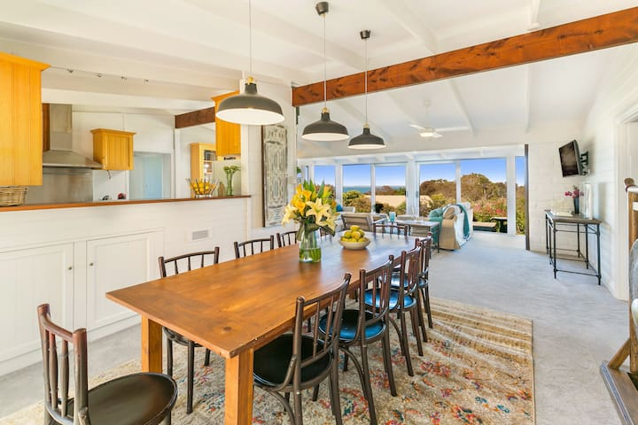 Spacious Dining Room with Garden and Bay Views