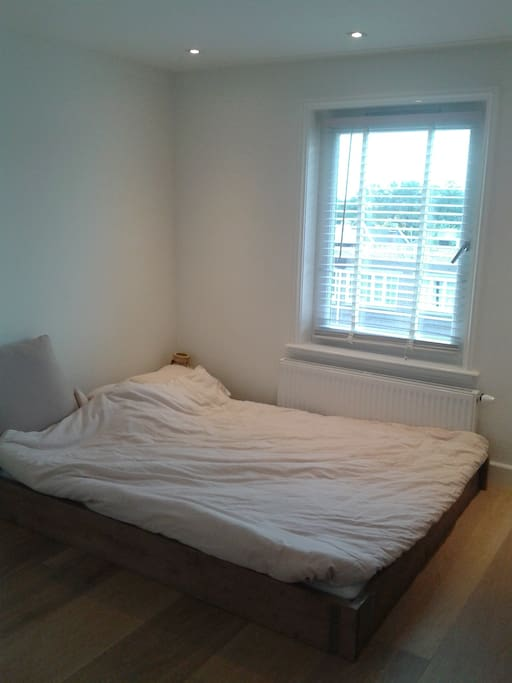 Comfy bed with high quality mattresses. Entrance bathroom on the right.