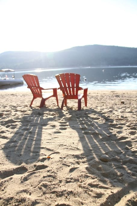 Adirondack chairs on our private beach