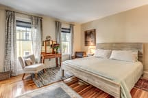 large master bedroom with king bed